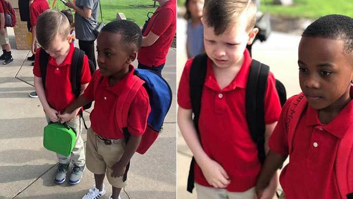 7zmut-kd-holds-hand-of-boy-first-day-of-school-2.jpg