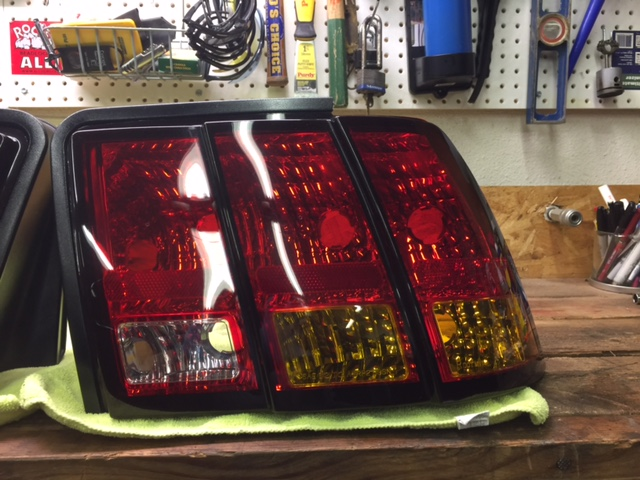set of amber tail lights, removed from 2001 cobra  in like-new condition,  with no scratches, cracks, etc  does not include wiring harness